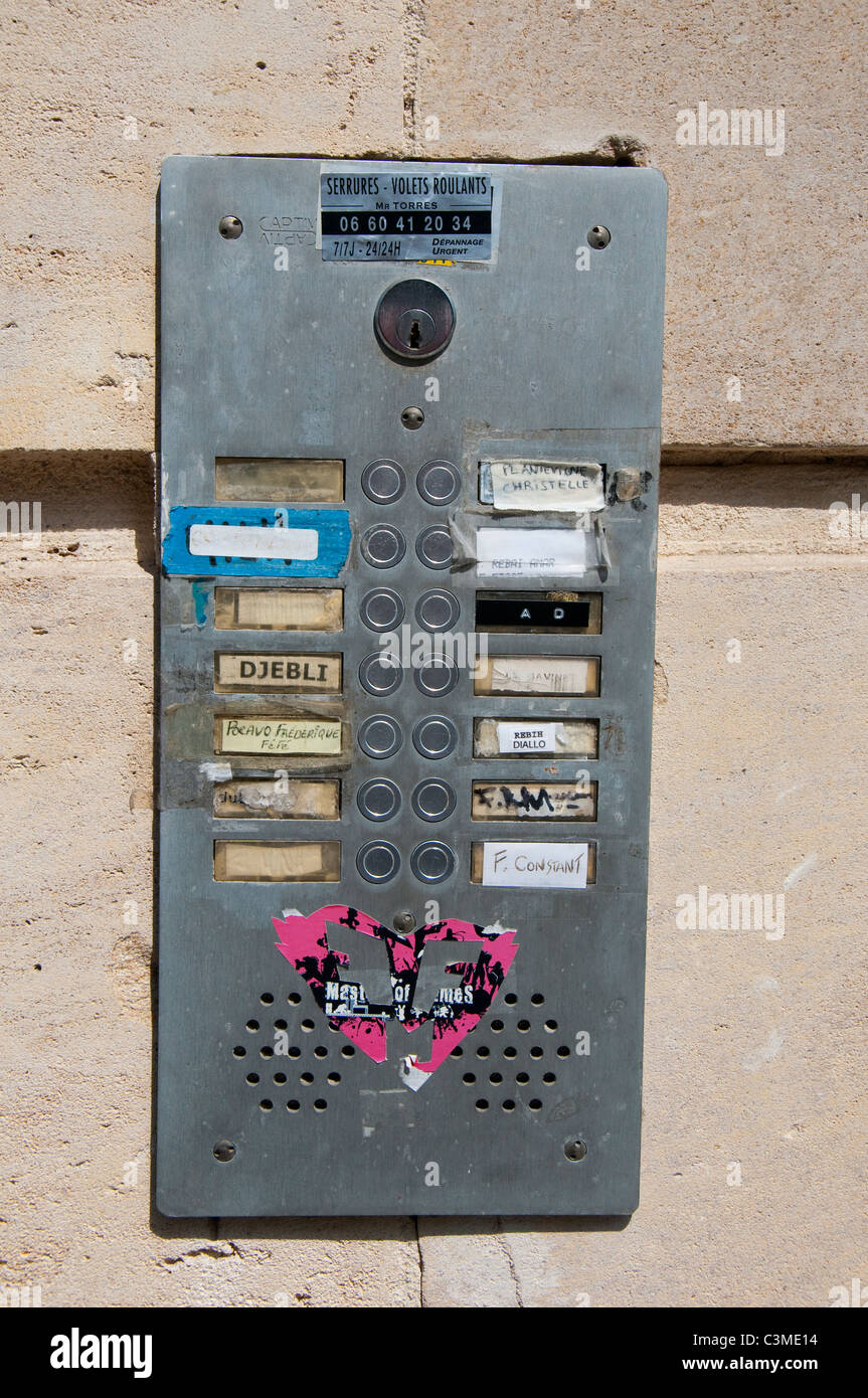 A Door Entry Intercom System And Names On A Building In The City Of