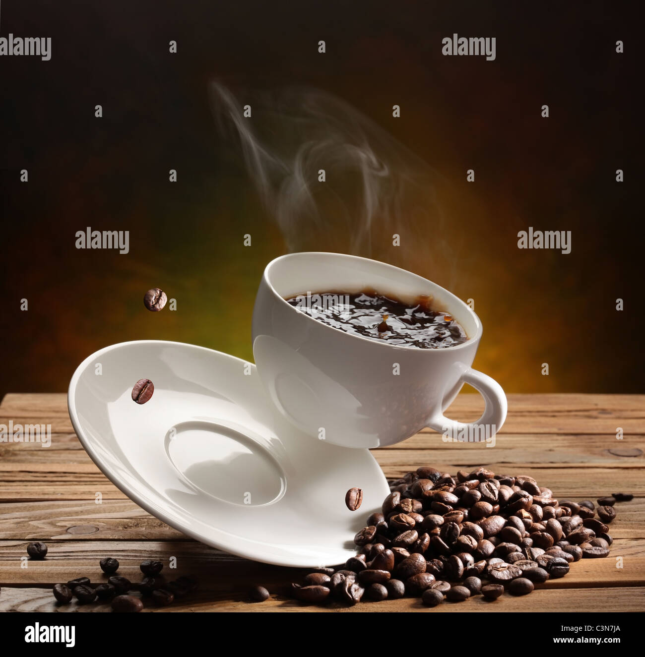 Falling coffee cup on the table - Stock Image
