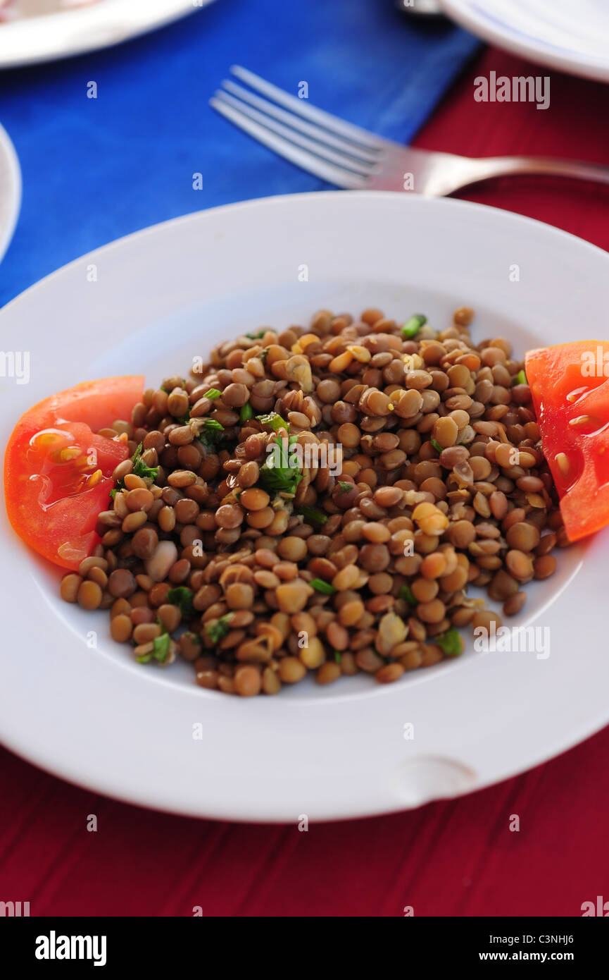 Africa Middle East Egypt Luxor Egytian food - lentils and tomatoes - lunch - Stock Image