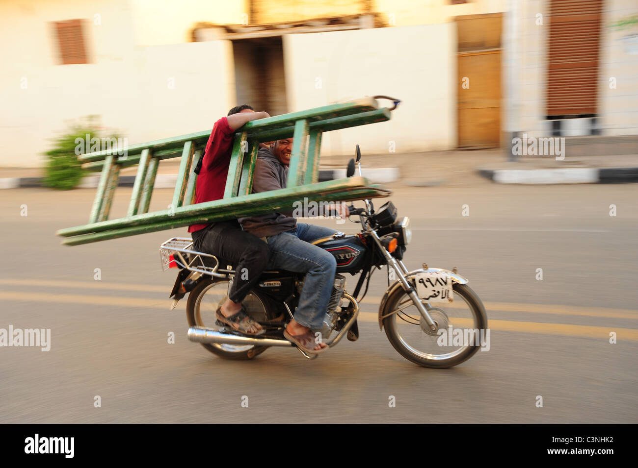 africa-middle-east-egypt-egyptian-luxor-men-riding-on-a-motorcycle-C3NHK2.jpg