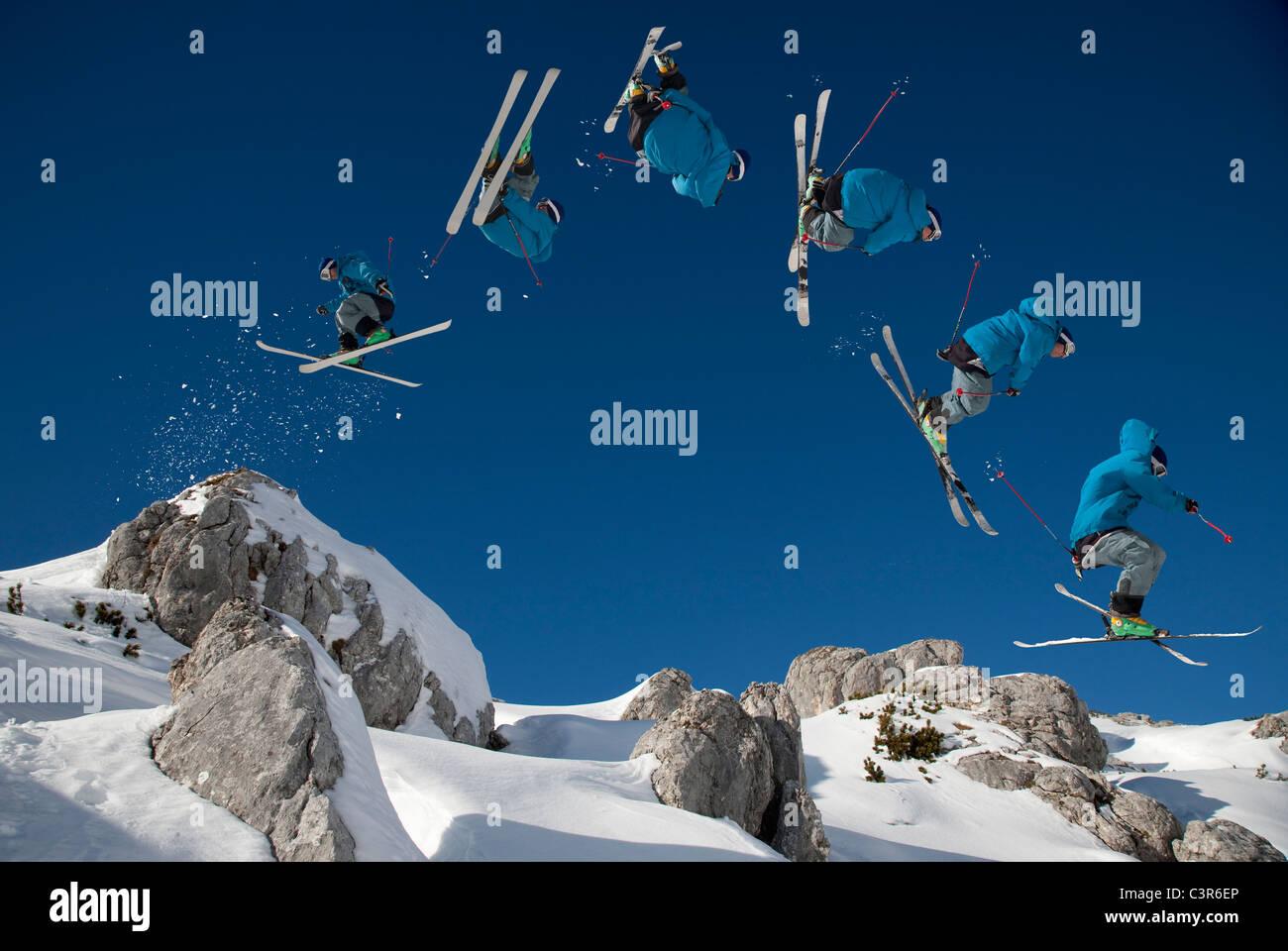 Skier doing dangerous free ride jump - Stock Image