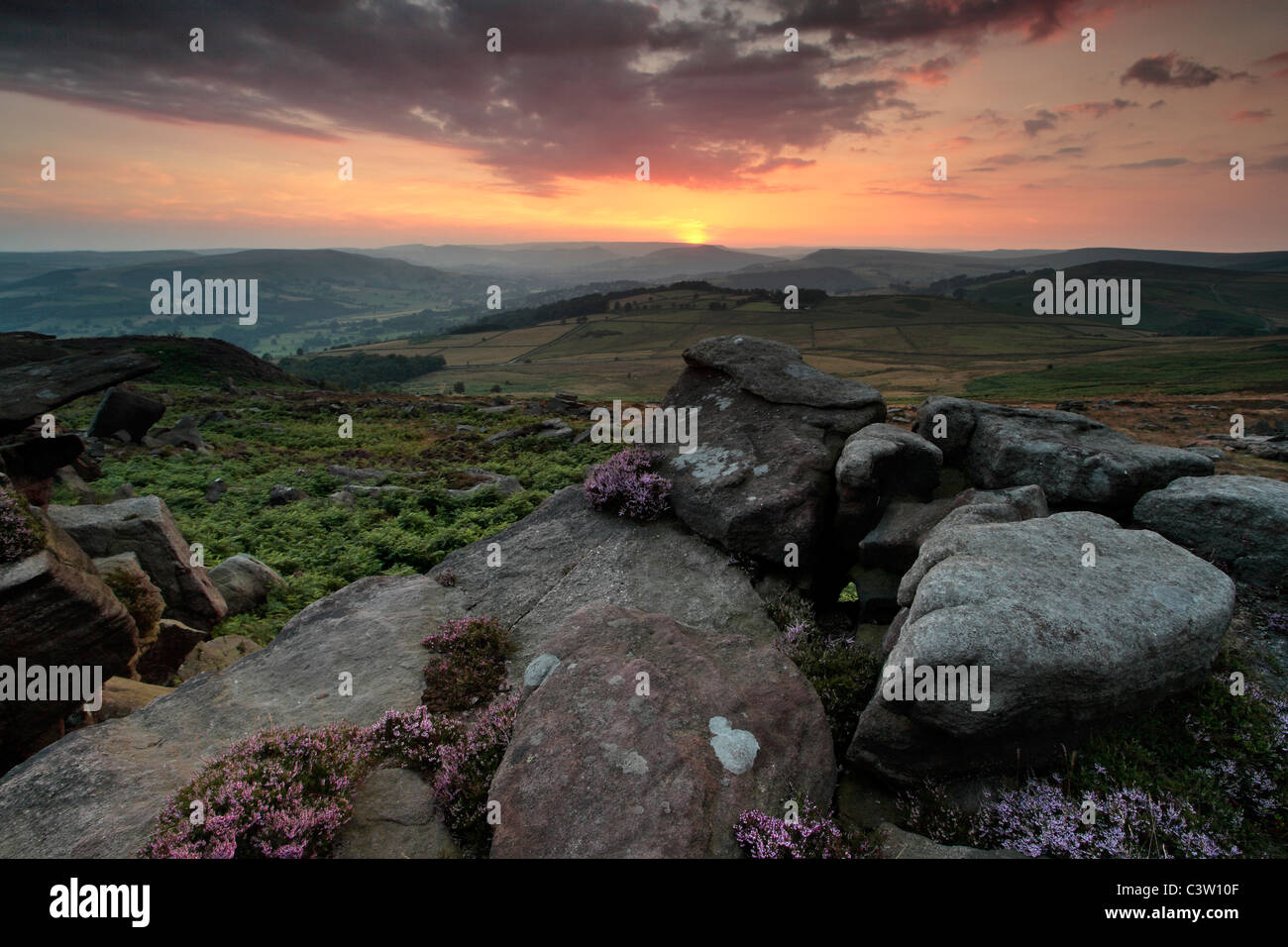 Sunset over the rocky landscape of the Peak District as seen near Owler Tor near Hathersage - Stock Image