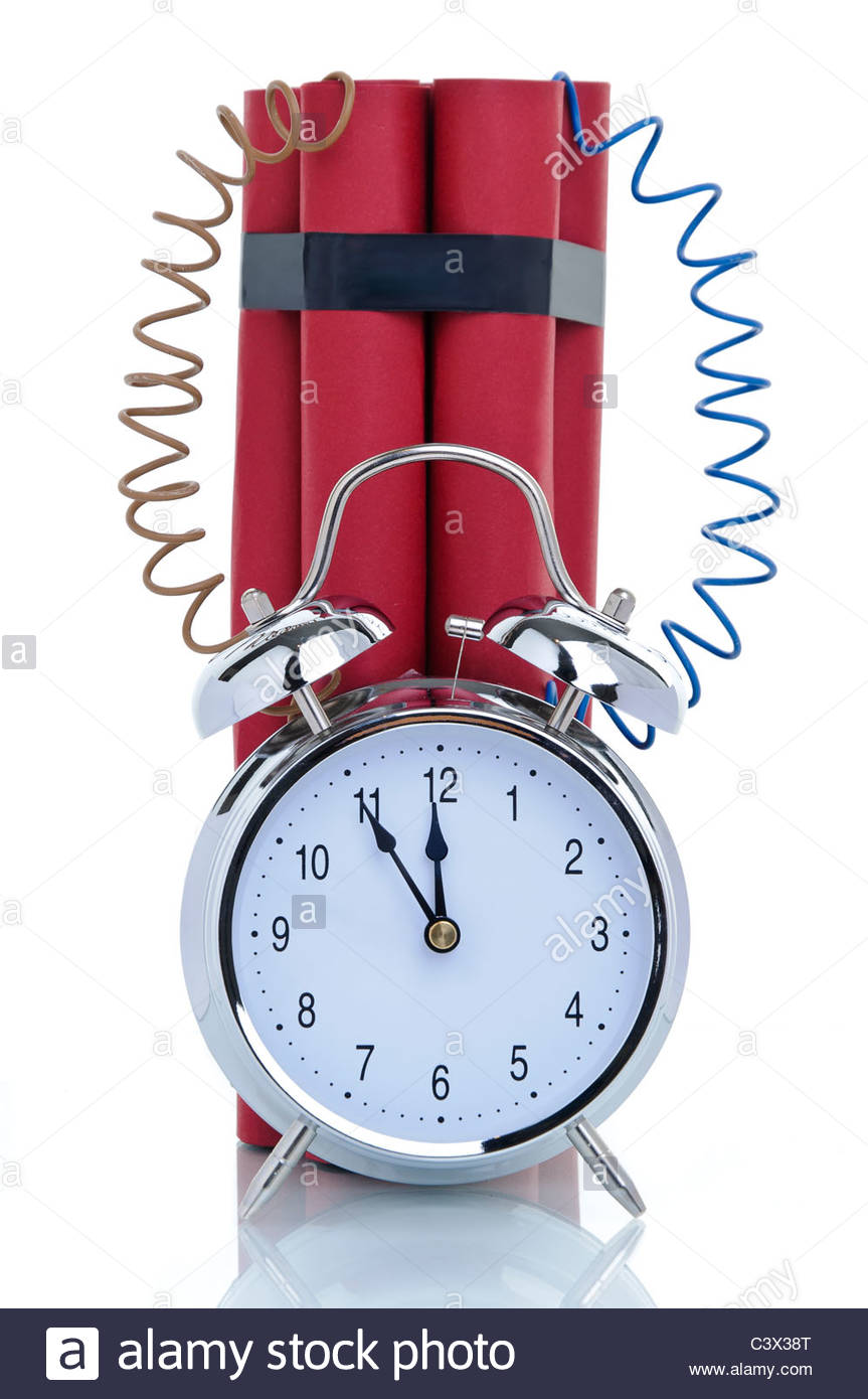Time bomb, alarm clock attached to dynamite sticks, symbolic image - Stock Image