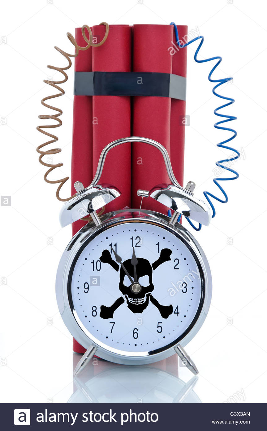 Time bomb, alarm clock with skull and dynamite sticks, symbolic image - Stock Image
