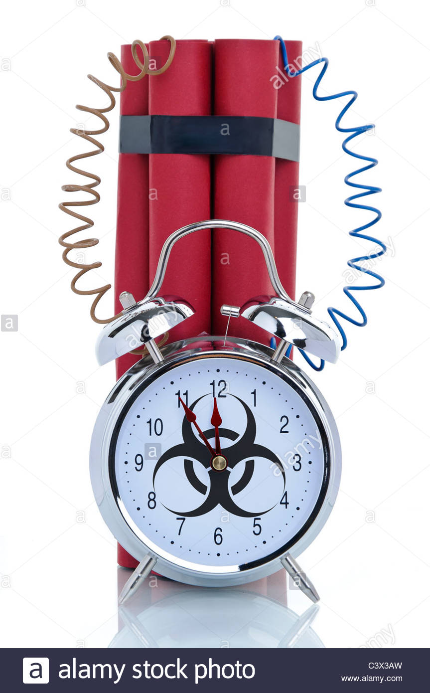 Time bomb, alarm clock with biohazard sign and dynamite sticks, symbolic image - Stock Image