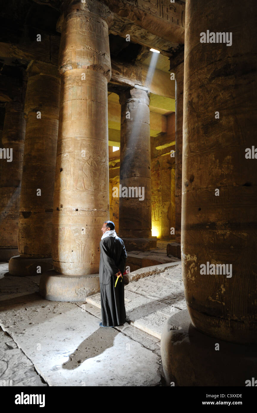 Africa Middle East Egypt Egyptian Ancient - Dendara House of Hathor - Man standing is a shaft of sun light inside Stock Photo