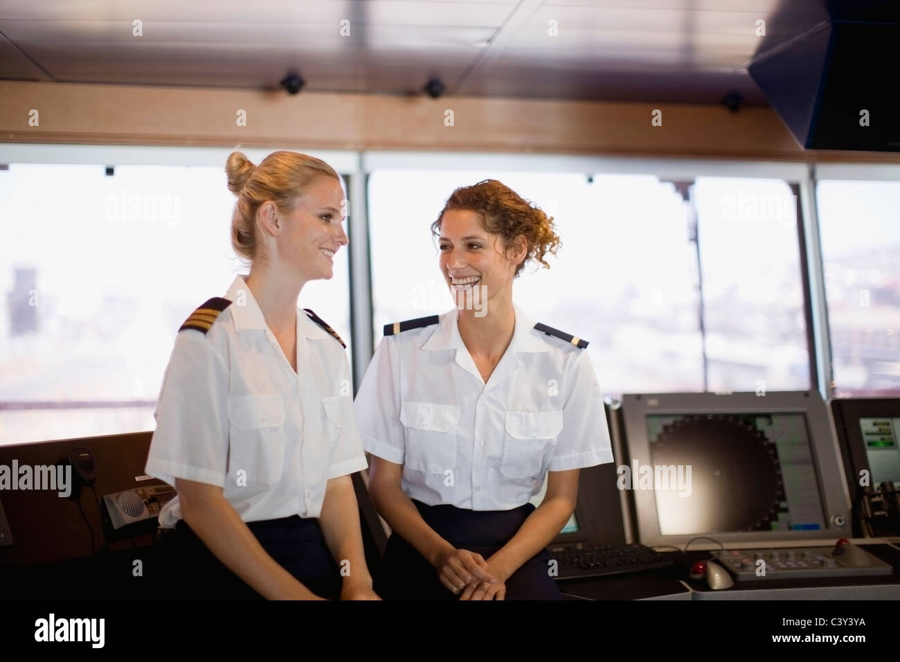 Female salors talking on ship - Stock Image