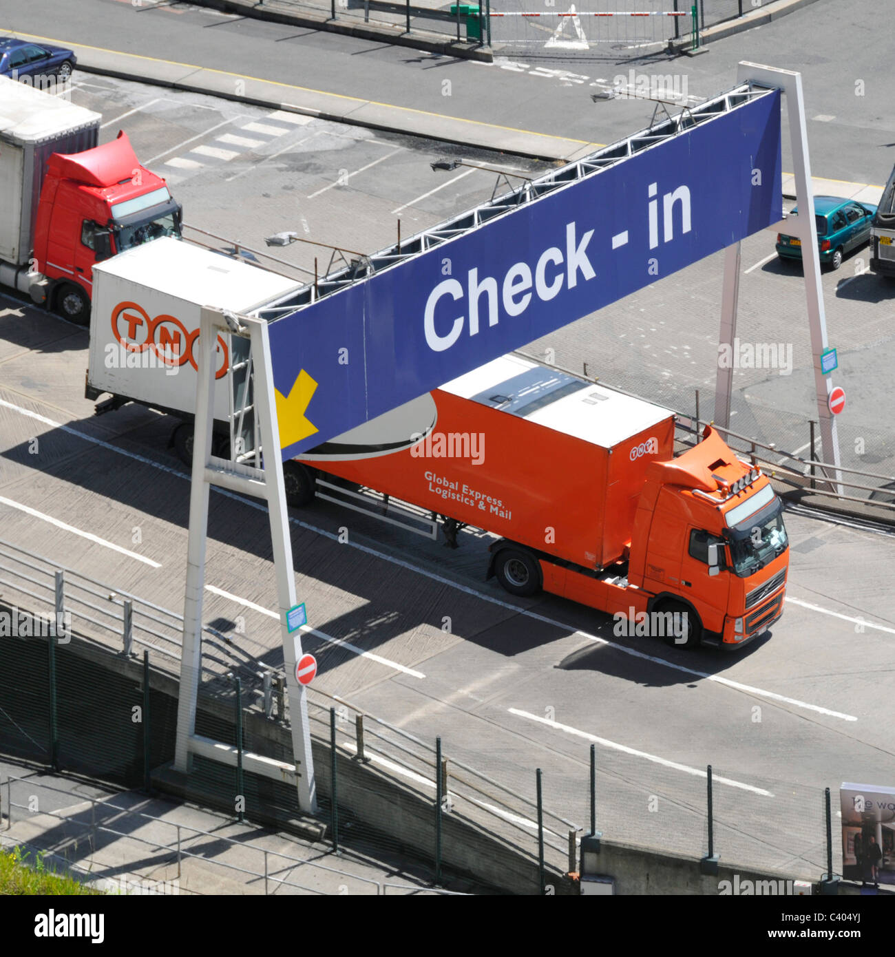 TNT trailer and lorry leaving Dover Ferry Terminal after arriving from continent - Stock Image