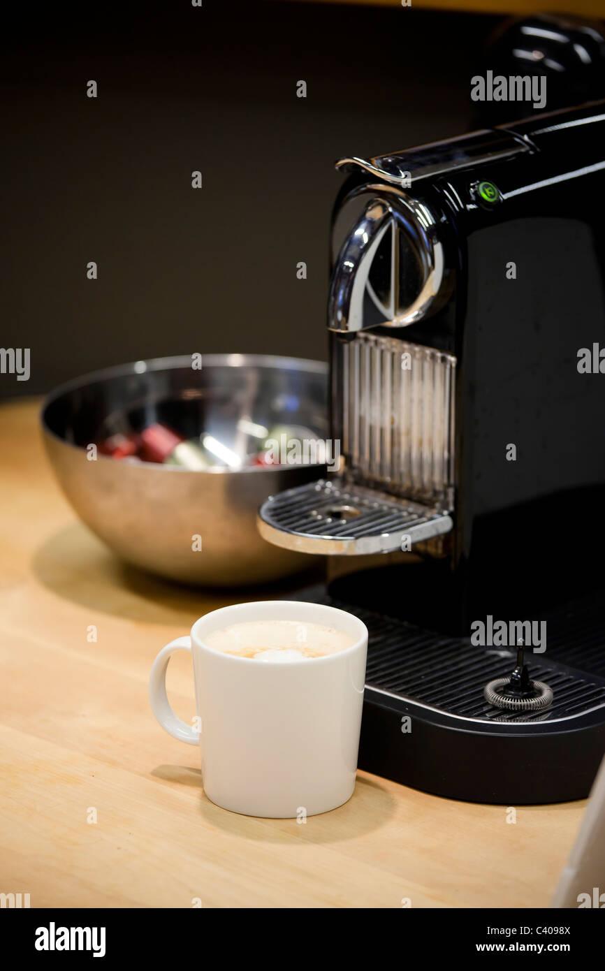 close up of nespresso coffee machine brewing freshly new espresso