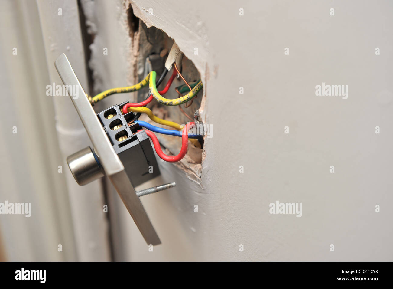 a faulty house light dimmer switch pulled away from wall showing rh alamy com Do It Yourself Home Wiring Basic Electrical Wiring Diagrams