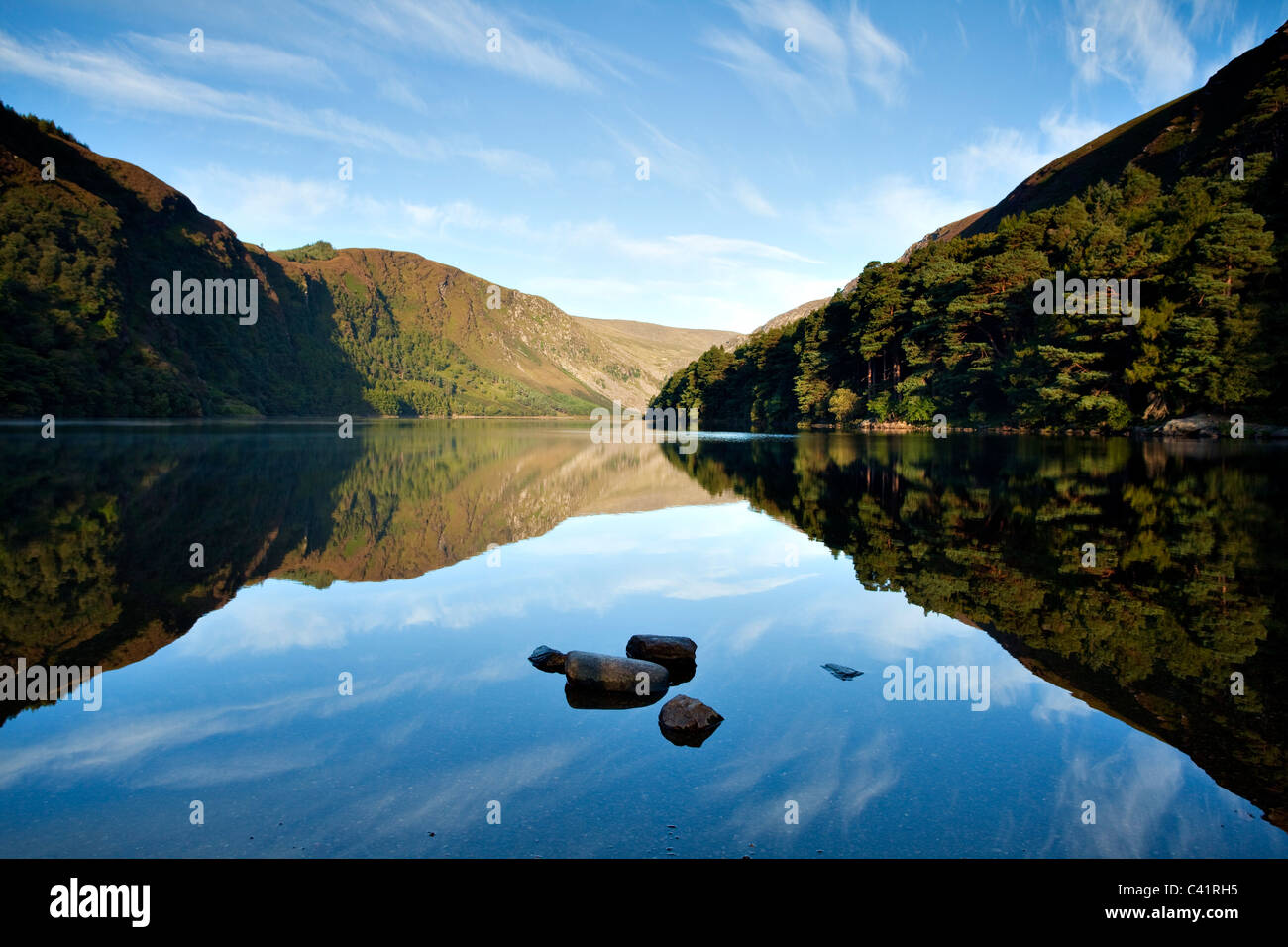 Morning reflections in Upper Lake, Glendalough, Wicklow Mountains National Park, County Wicklow, Ireland. - Stock Image