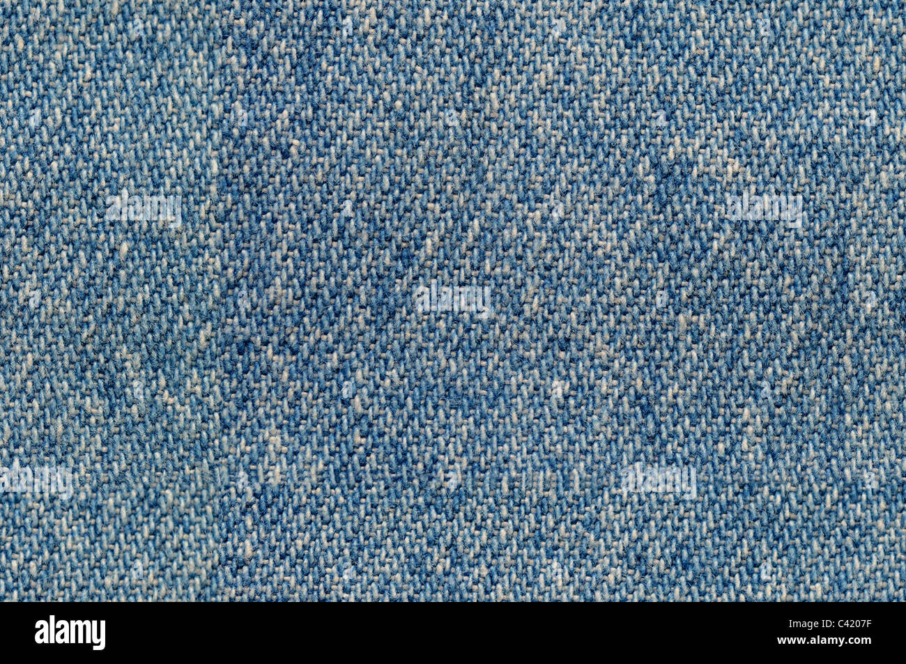 Blue denim cloth fabric background seamlessly tileable - Stock Image