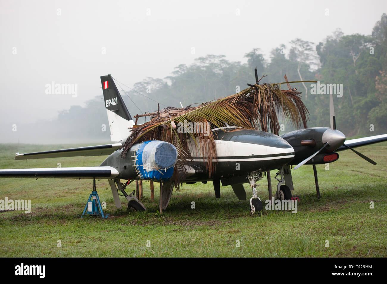 Peru, Boca Manu, Brooken airplane on landing strip. - Stock Image
