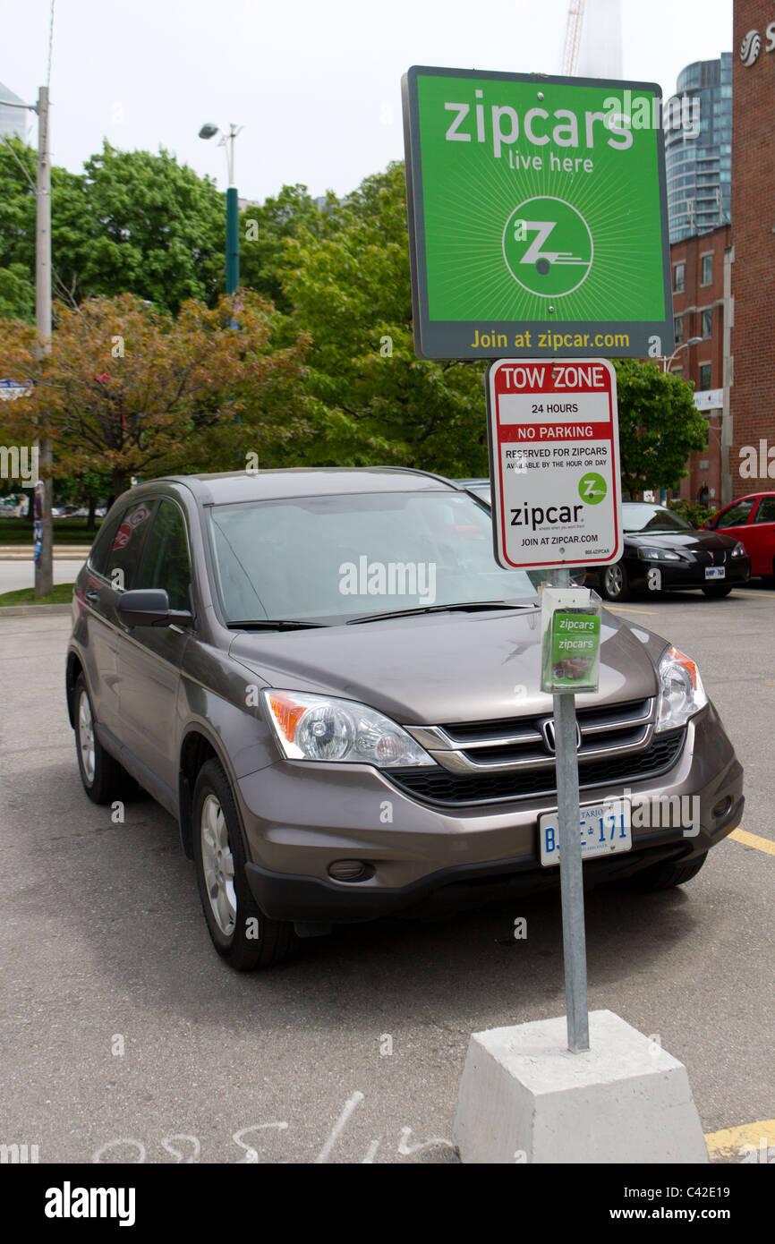 A honda crv parked at a zip car spot - Stock Image