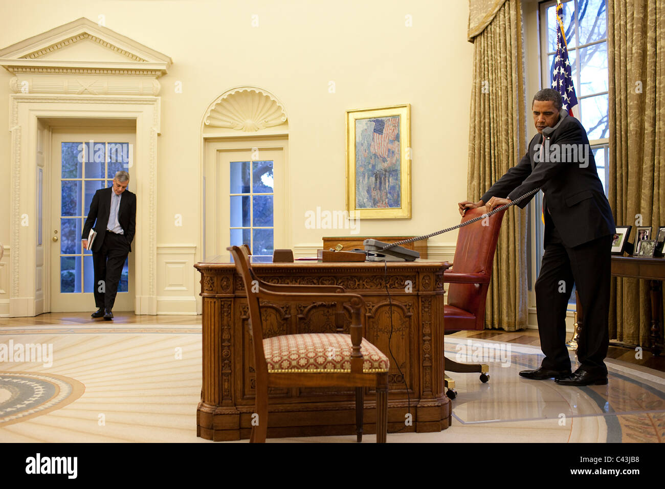 the oval office. president barack obama with rahm emanuel in the oval office white house