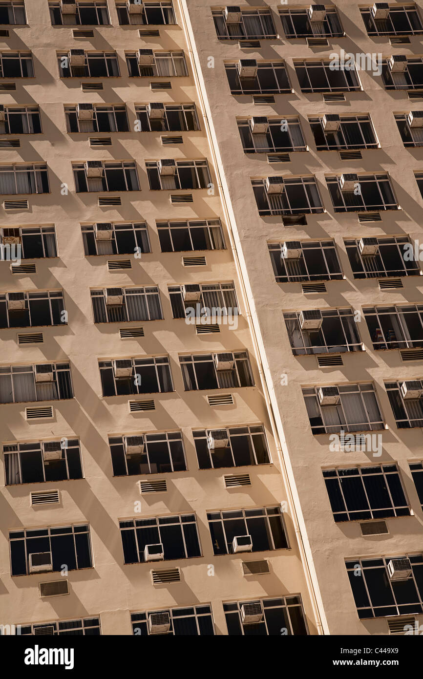 Tower block of flats with air conditioners on each window Stock Photo