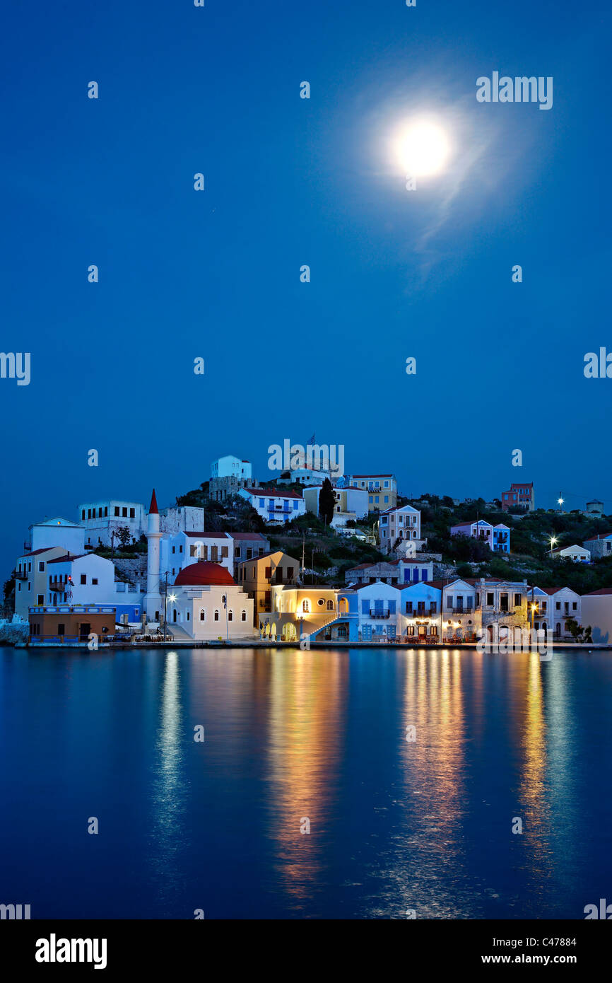 Night  view (full moon) of the picturesque village of Kastellorizo (or 'Meghisti') island, Dodecanese, Greece - Stock Image