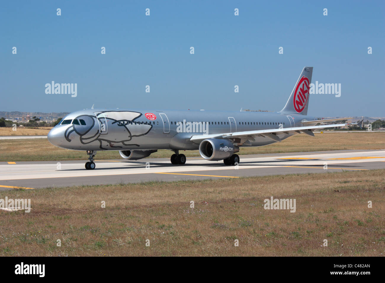 Commercial air travel. Niki Airbus A321 taxiing for departure from Malta - Stock Image