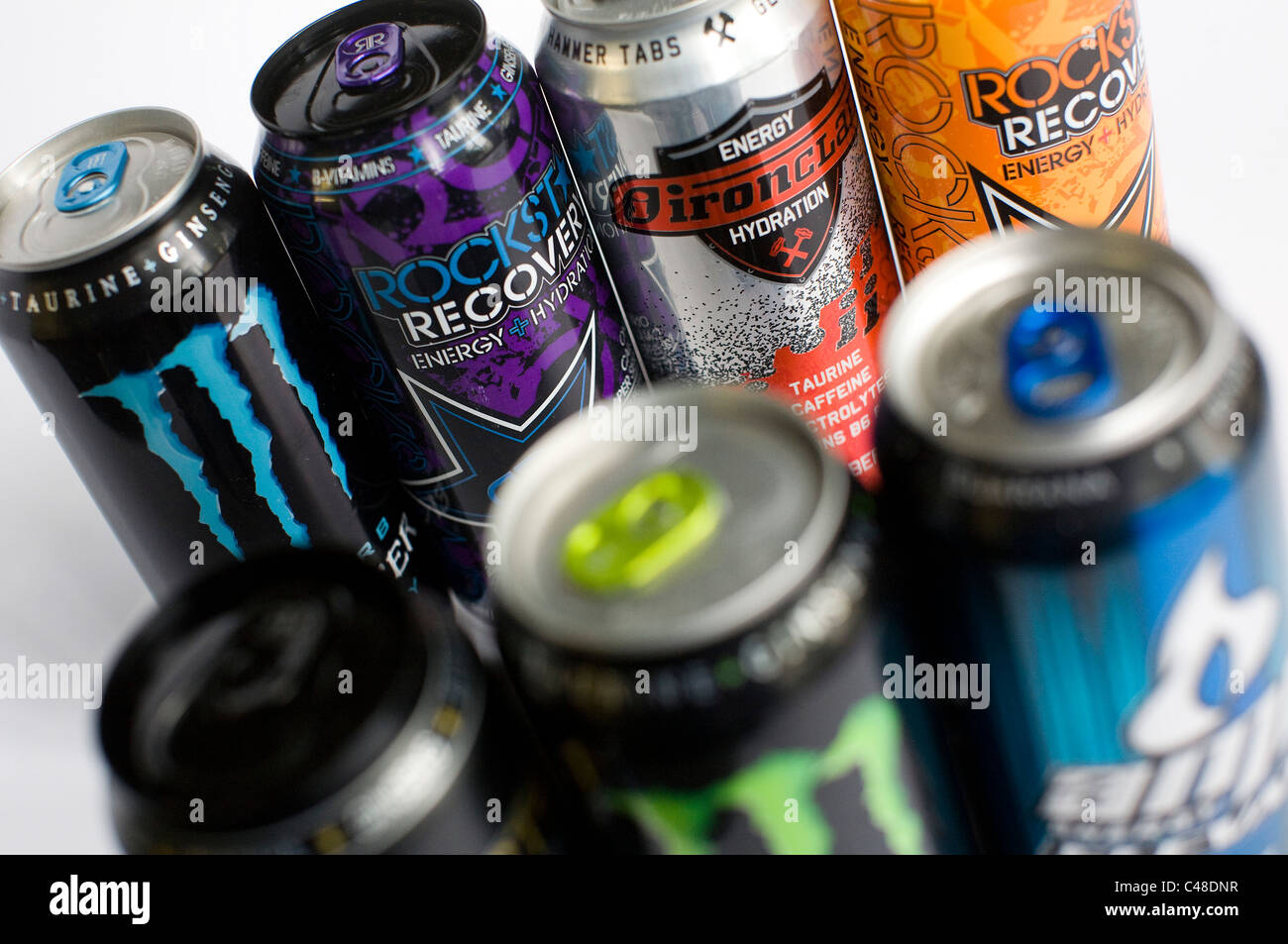 A mix os RockStar, Monster, AMP and Red Bull energy drinks.  Stock Photo