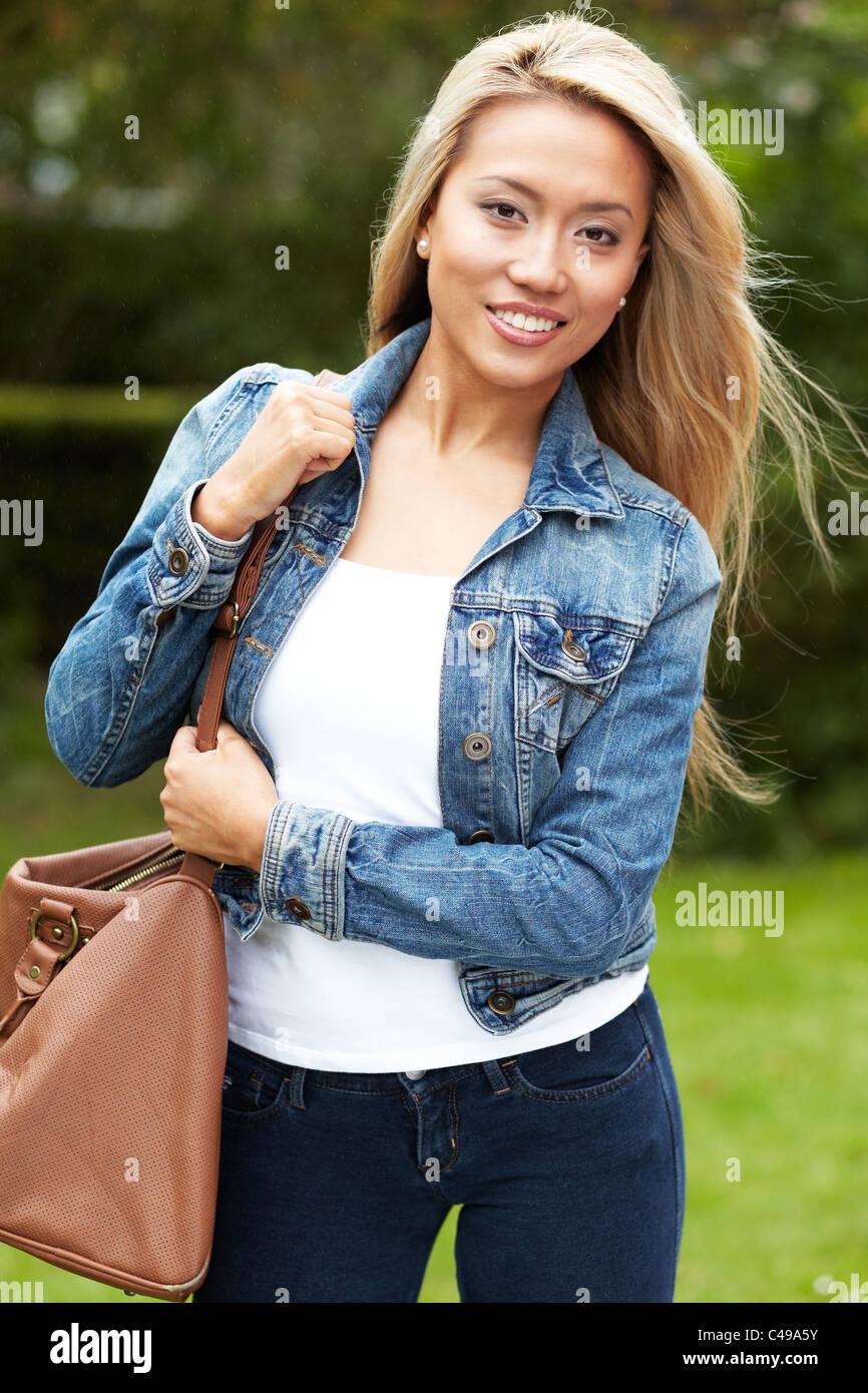 Portrait of pretty ethnic girl - Stock Image