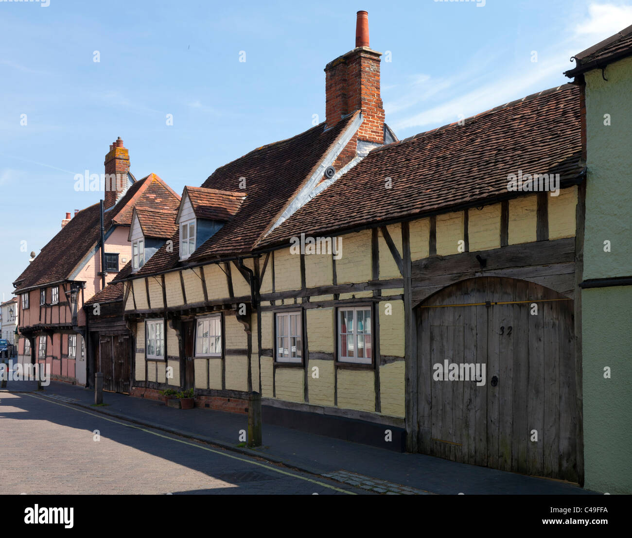 Old House dwelling Titchfield Hampshire England UK High Street timber frame wood wooden yellow pink weathered oak - Stock Image