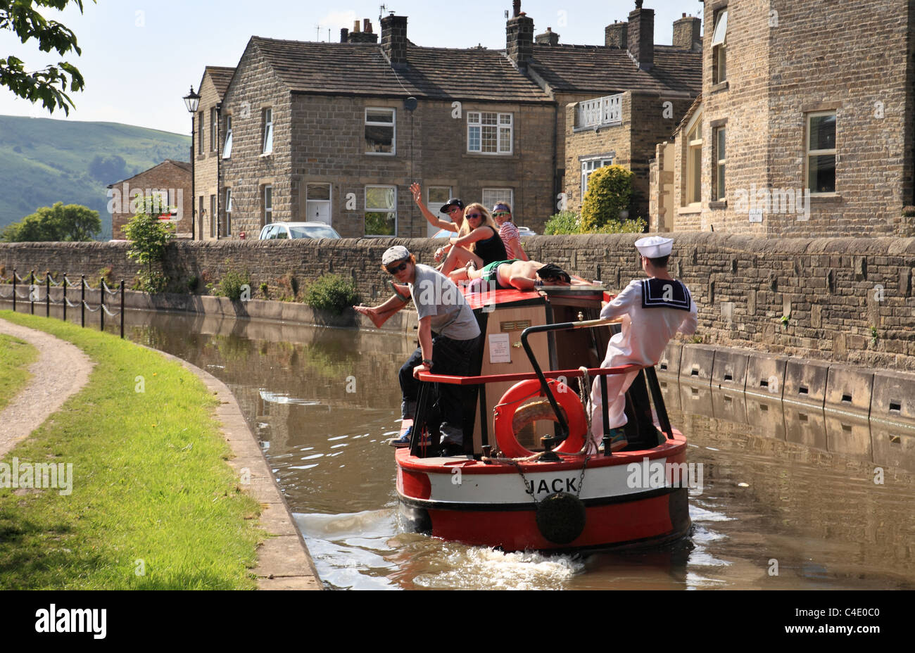 young-people-having-fun-on-a-canal-boat-