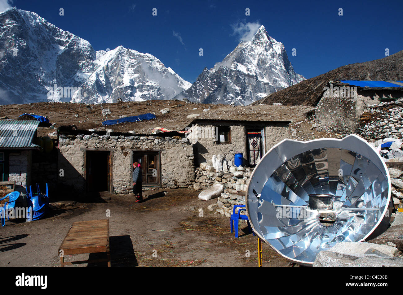 A trekking lodge with a parabolic heater in the Nepal Himalayas Stock Photo