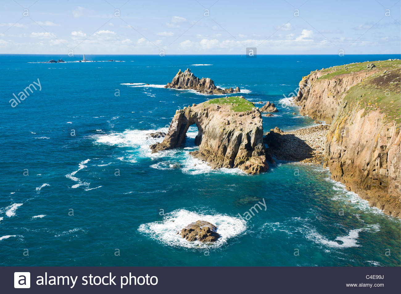 Enys Dodman, The Armed Knight, and the Longships lighthouse at Land's End, Cornwall, England. - Stock Image