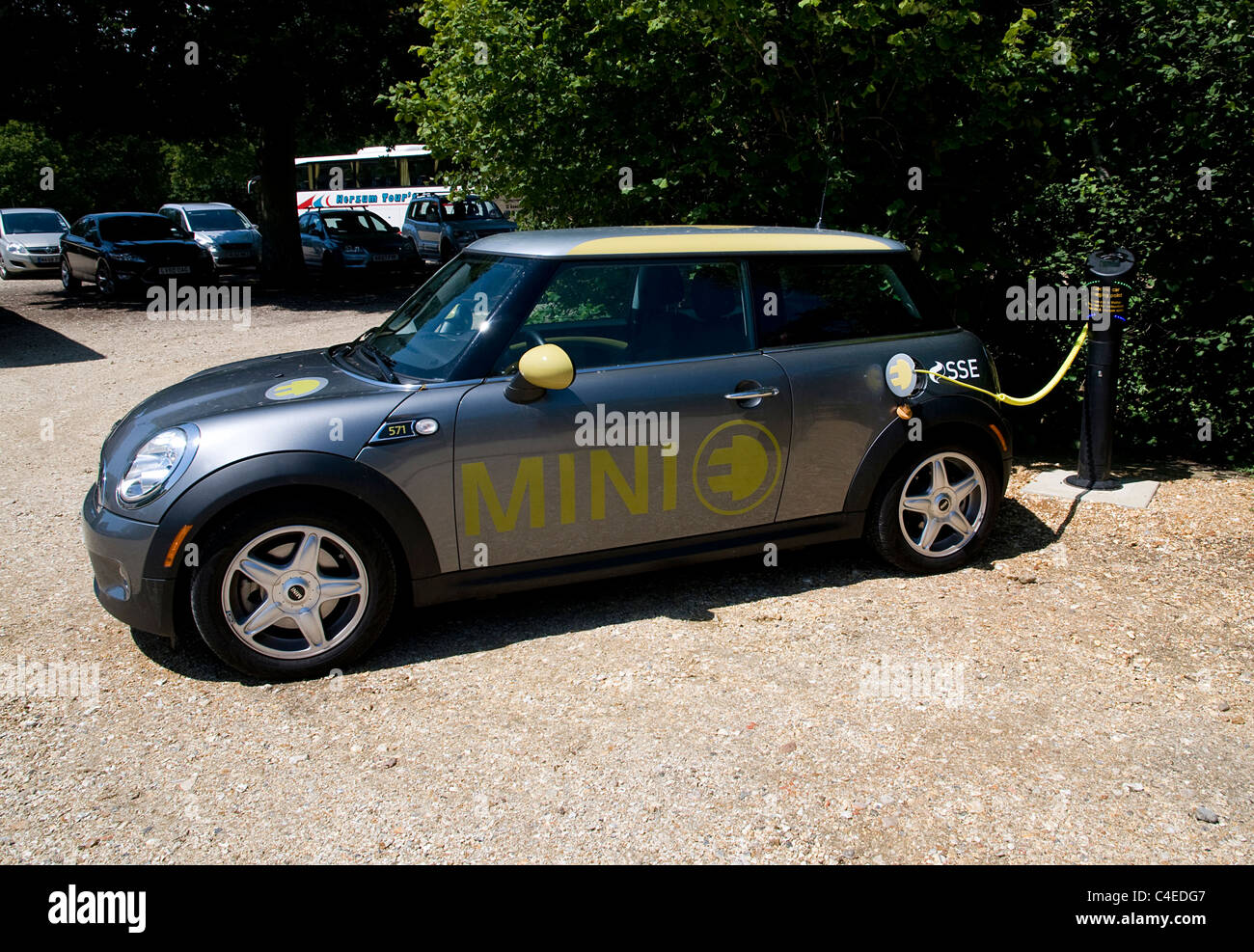 2011 Mini E Electric car at battery charging point - Stock Image