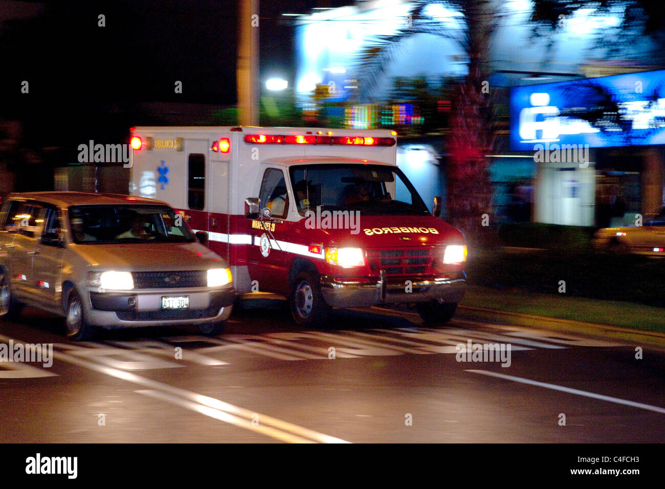 Ambulance in motion in the Miraflores district of Lima, Peru. - Stock Image