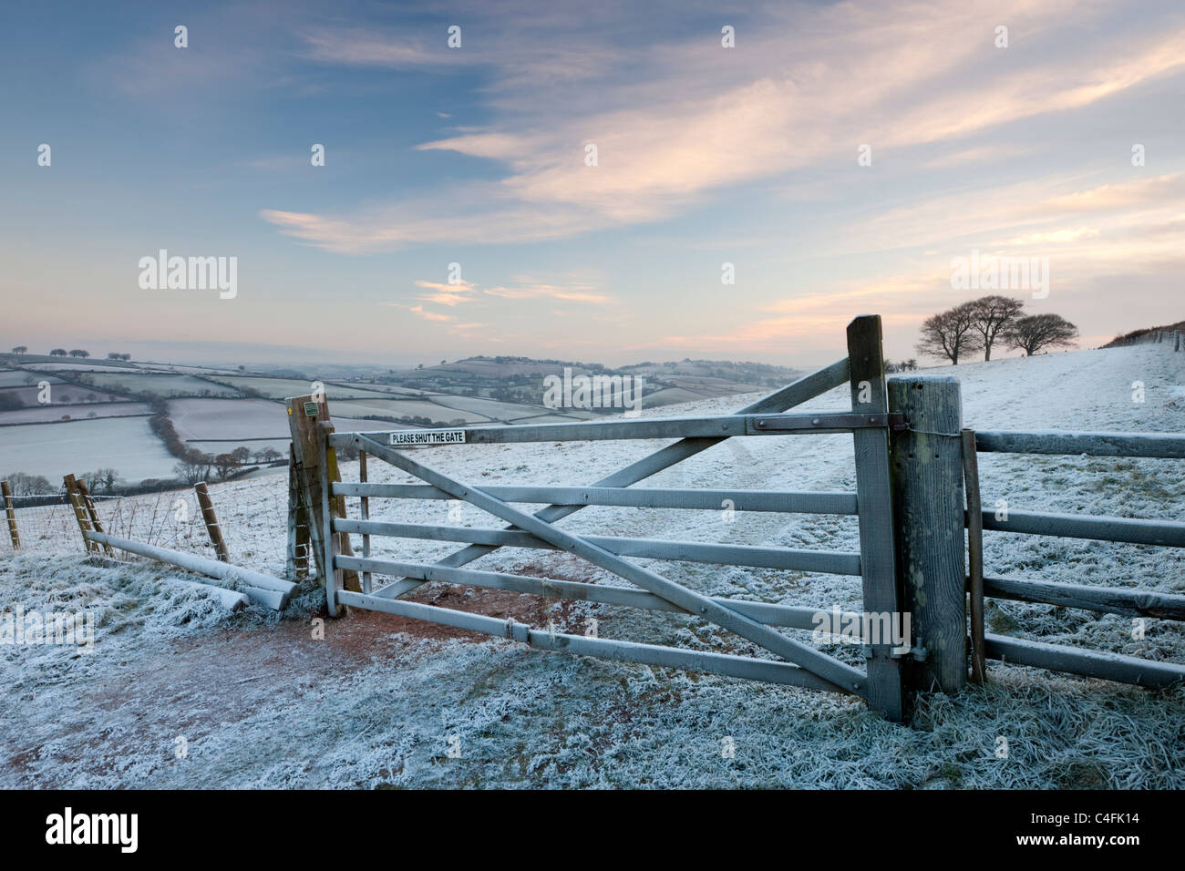 Frost covered wooden gate and field, Raddon Hills, Devon, England. Winter (December) 2010. - Stock Image