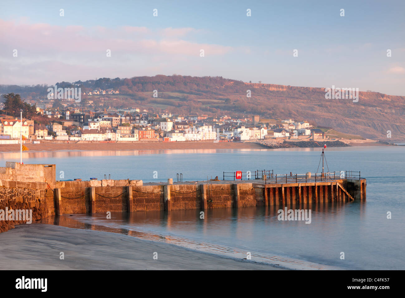 Stone quay and Lyme Regis town viewed from the Cobb, Lyme Regis, Dorset, England. Winter (December) 2010. - Stock Image