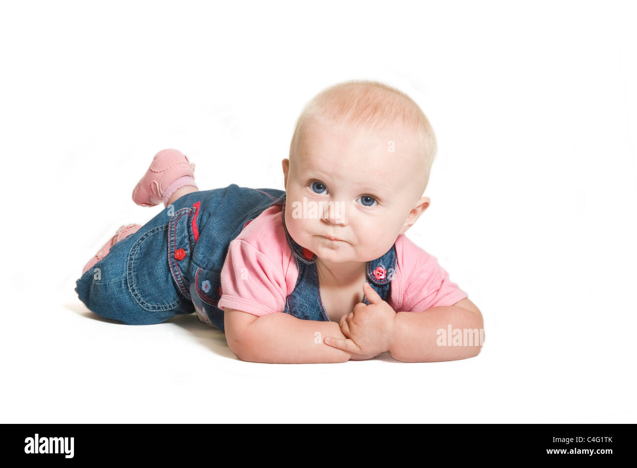 a cute 1 year old baby girl with blue eyes wearing denim and pink