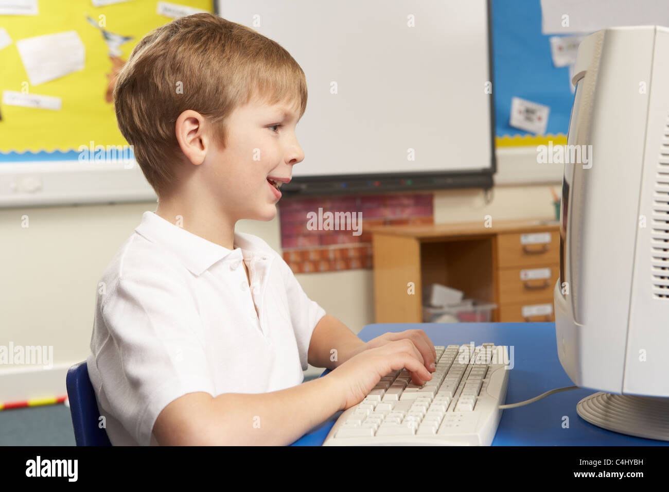 Schoolboy In IT Class Using Computer - Stock Image