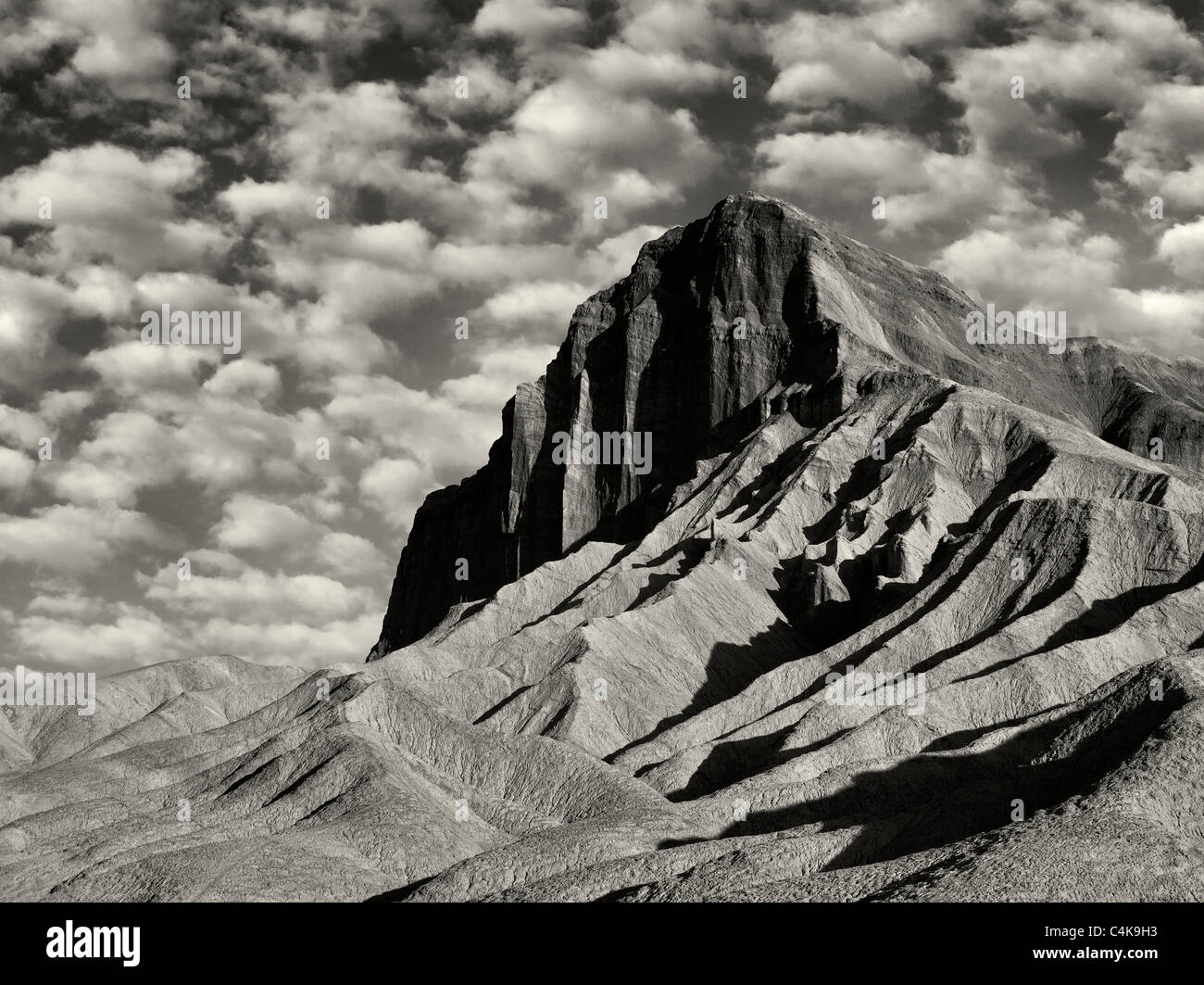 Manly peak as seen from Golden Canyon Trail. Death Valley National Park, California. Sky has been added. - Stock Image