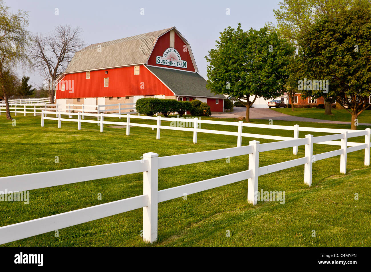 A red barn at the Sunshine Farm and Essenhaus in Middlebury, Indiana, USA. - Stock Image
