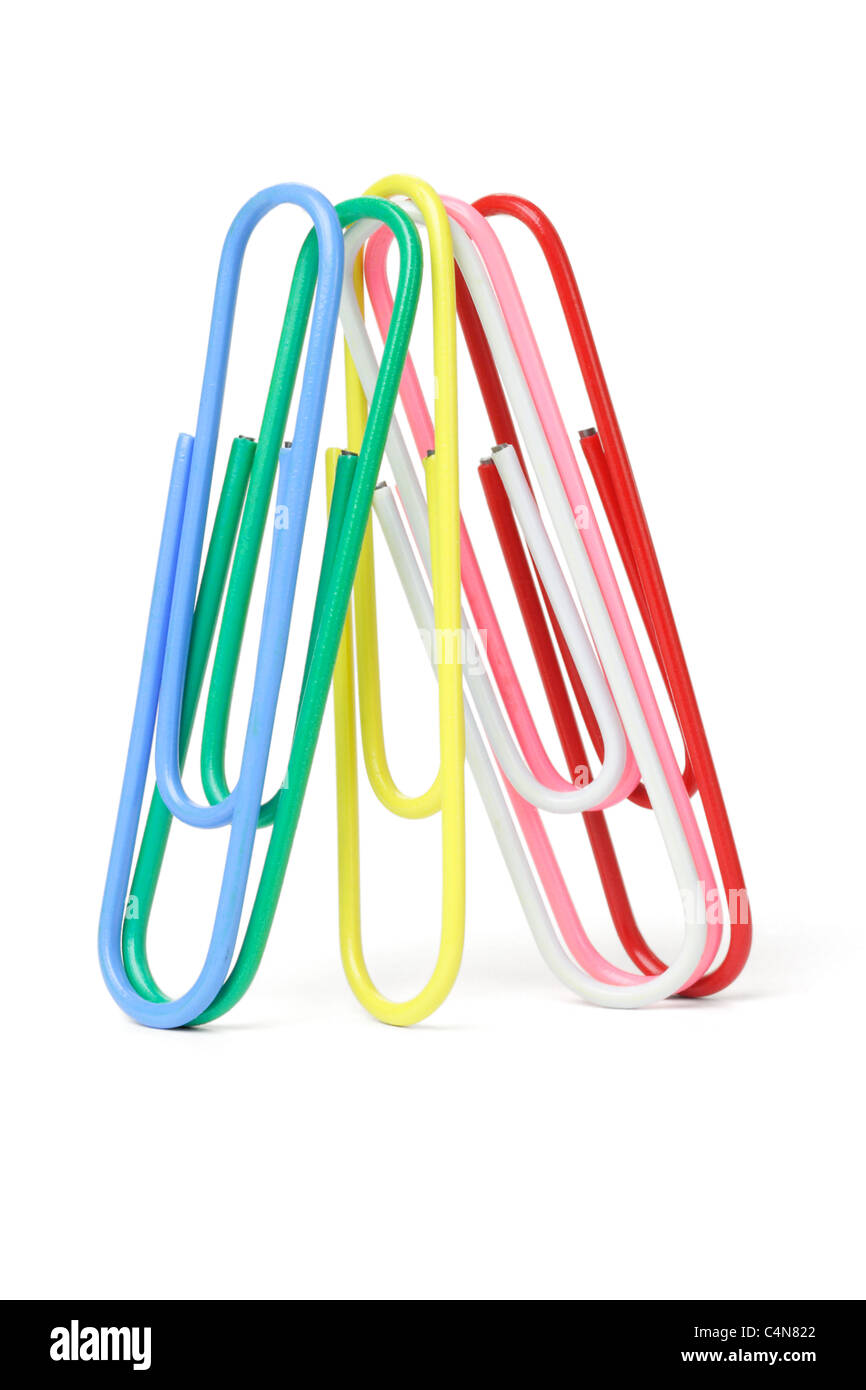 Multicolor paper clips standing on white background - Stock Image