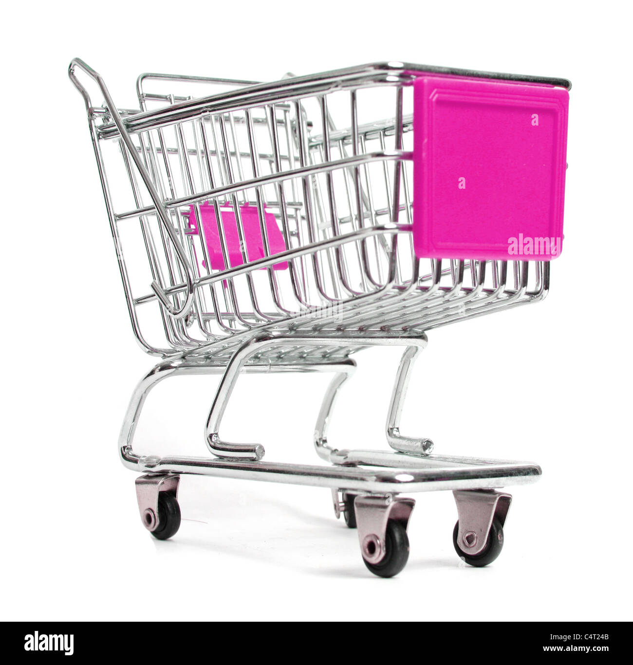 A miniature shopping trolley in studio - Stock Image