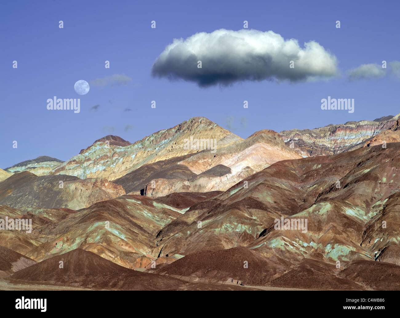 Colorful hills and moon. Death Valley National Park, California - Stock Image