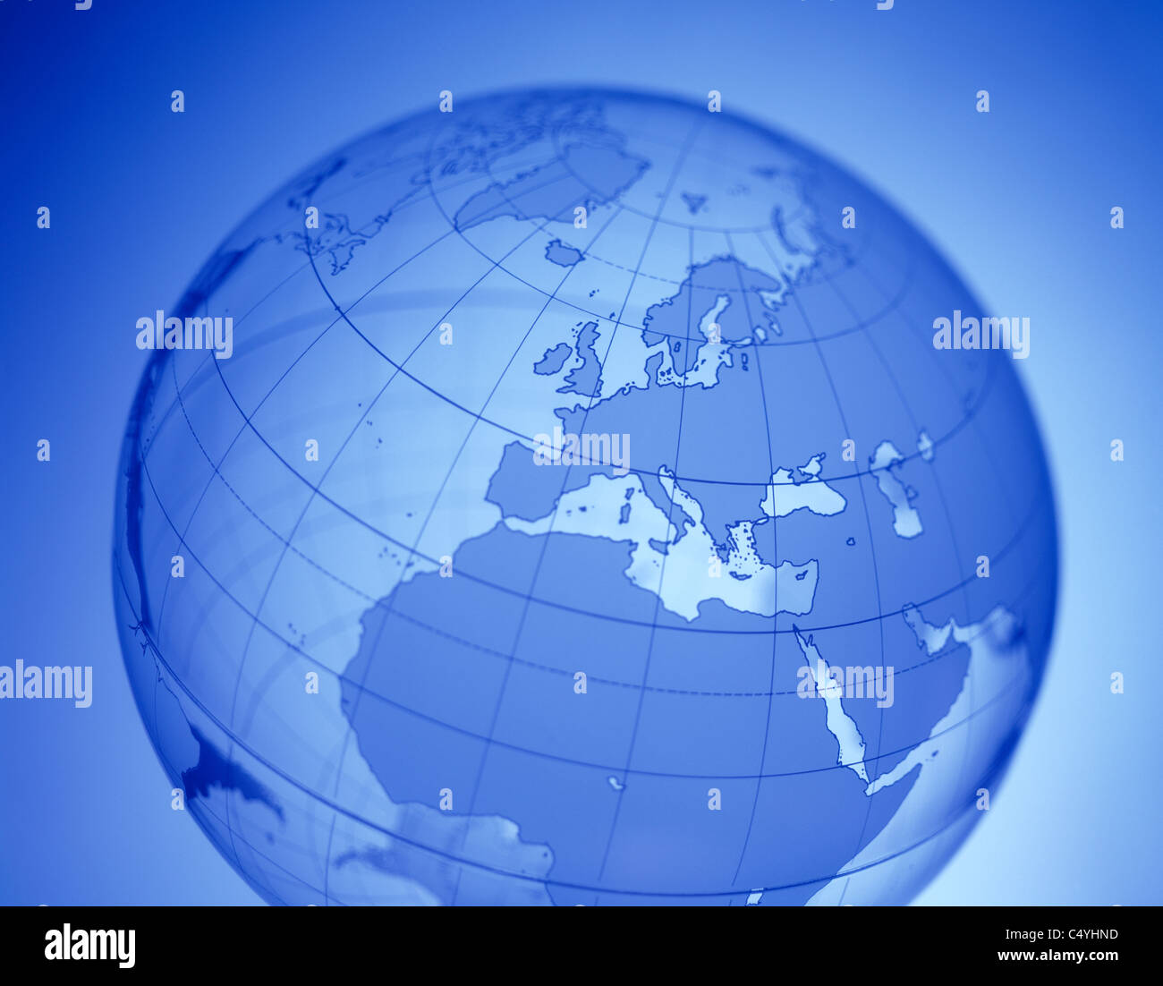 A clear glowing word globe featuring Europe in the center - Stock Image