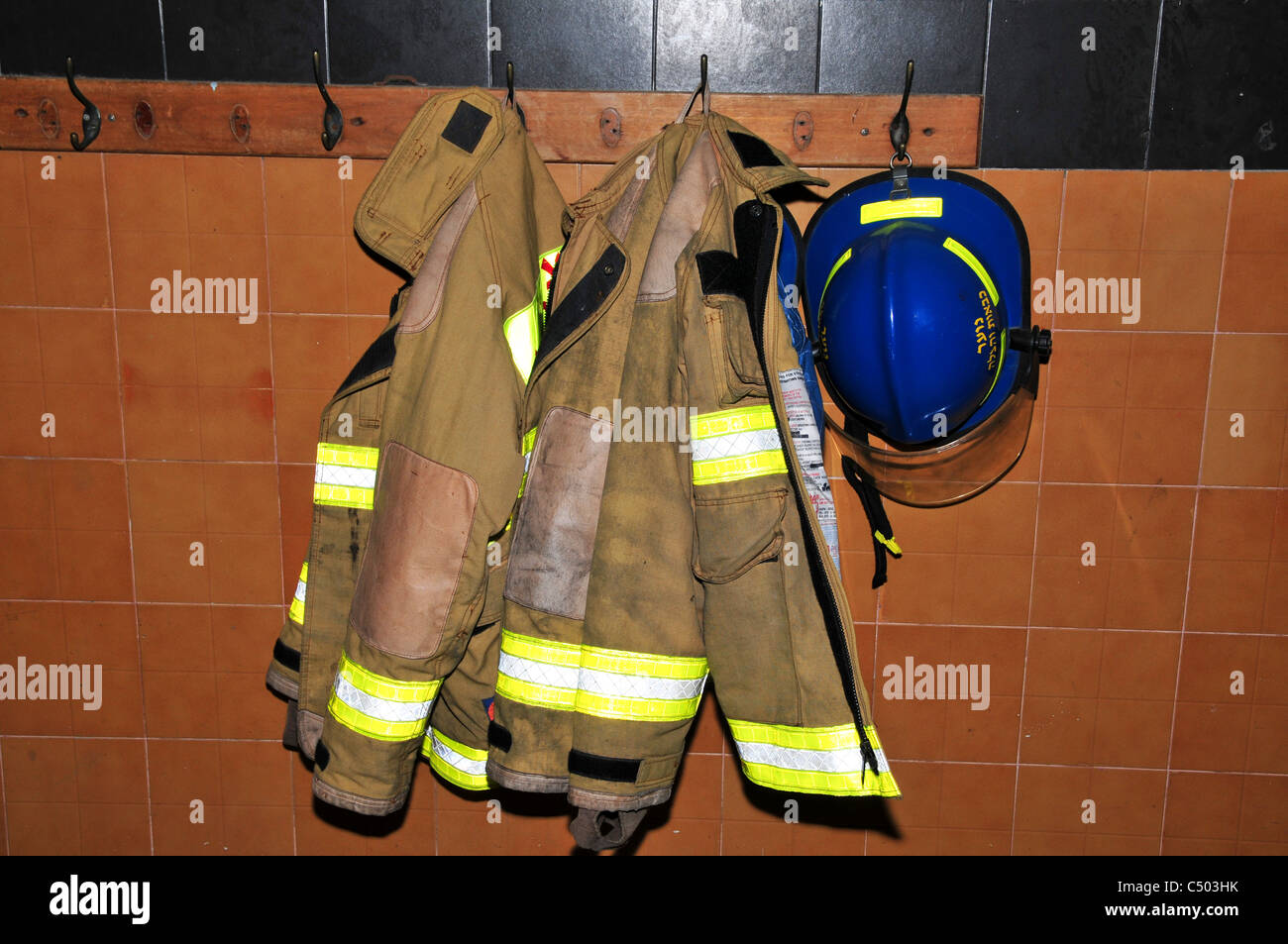 Fire fighters equipment Coats and Helmets - Stock Image