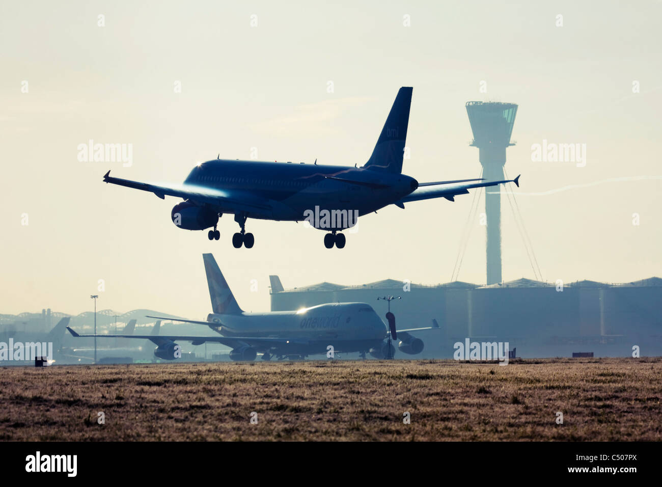 Airplane landing at London Heathrow Airport. Stock Photo
