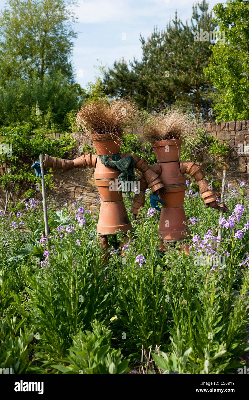 Flower Pot Scarecrows In The Fruit And Vegetable Garden In April At RHS  Rosemoor, Devon, England, United Kingdom