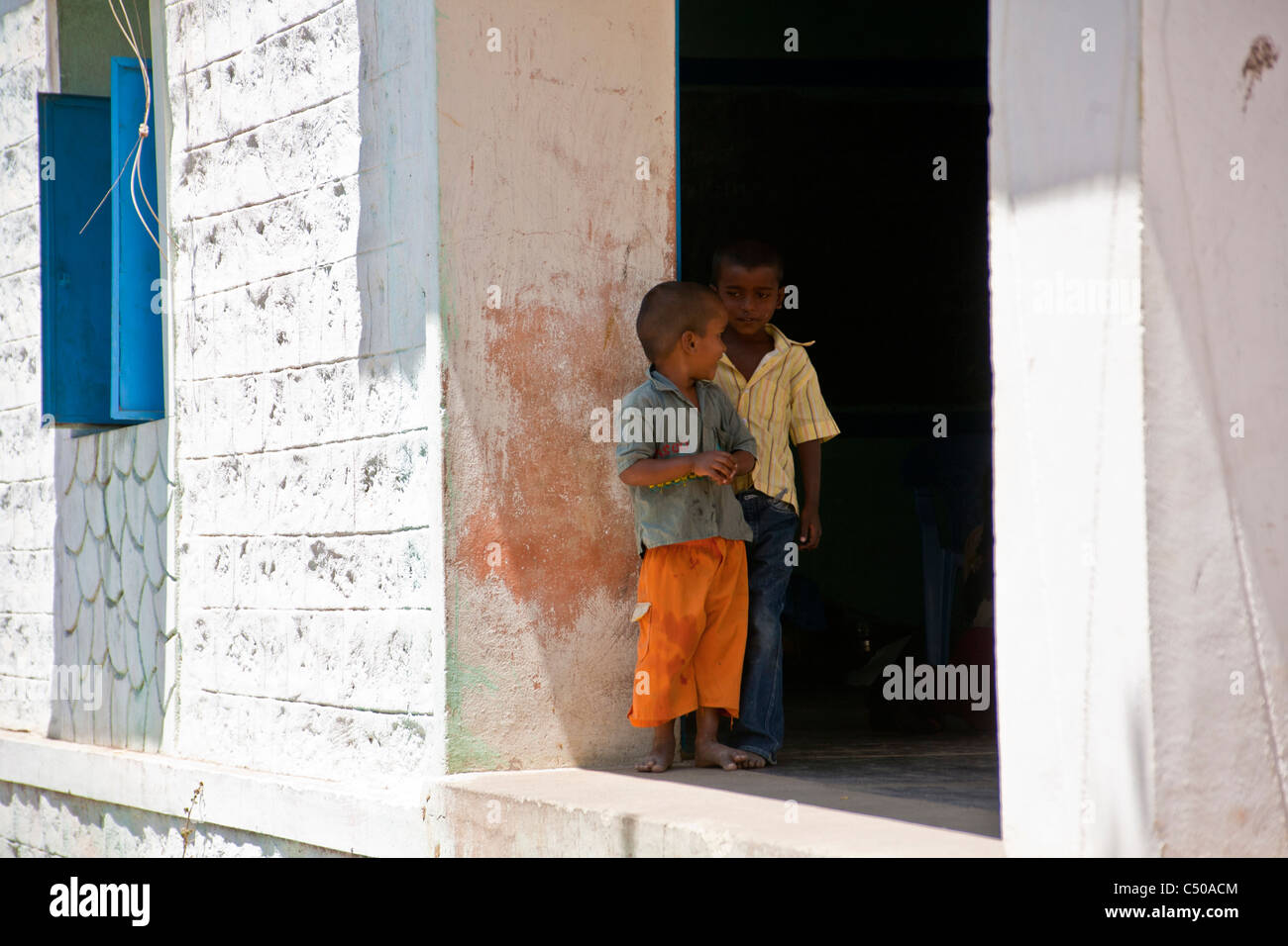 Two small indian boys discussing in a rural village near Hampi, Karnataka province, India. - Stock Image