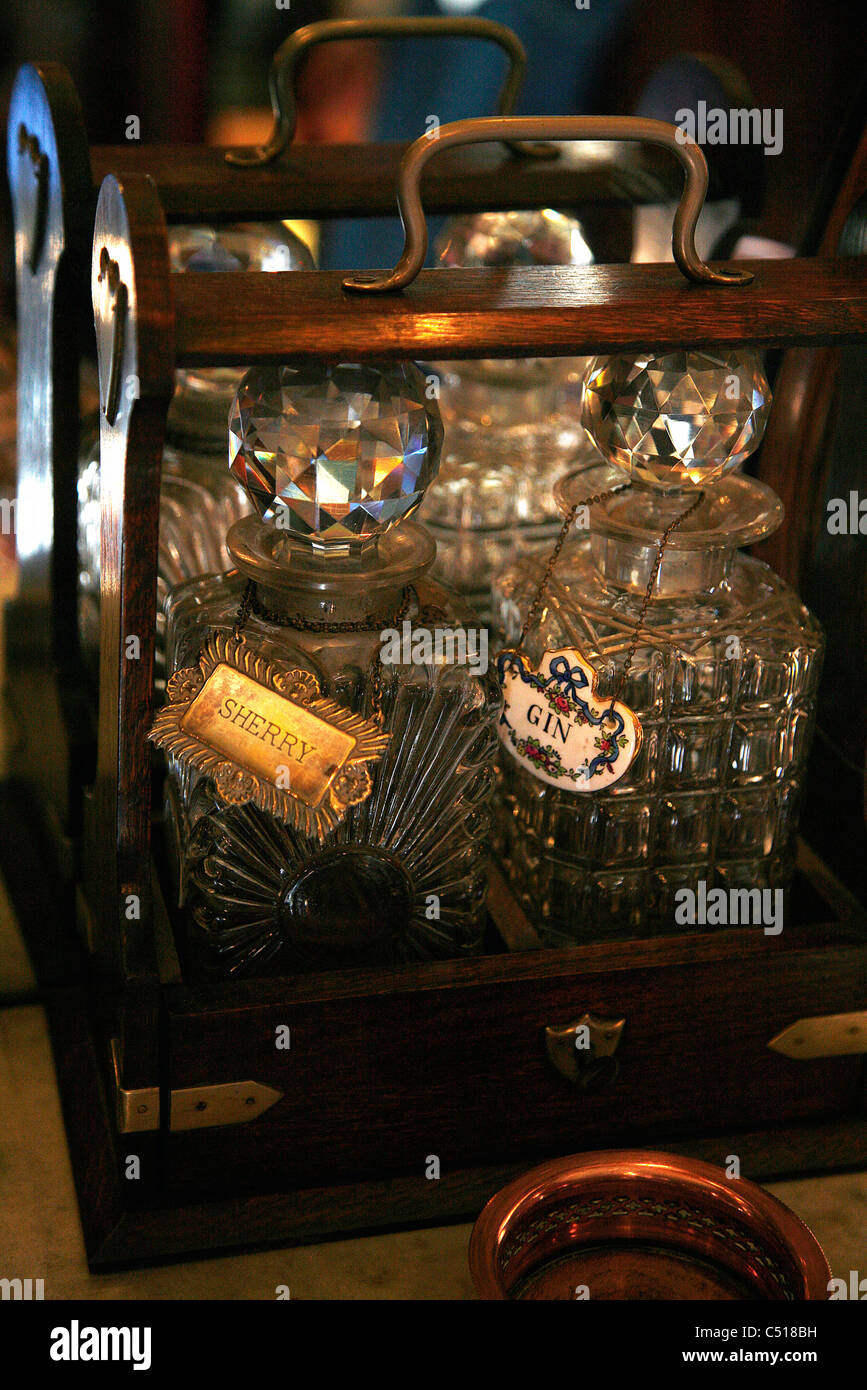 Decanters of liquor in wooden carrying case - Stock Image