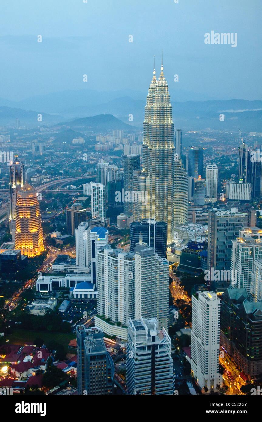 Petronas Twin Towers illuminated at night, Kuala Lumpur, Malaysia, Southeast Asia, Asia - Stock Image