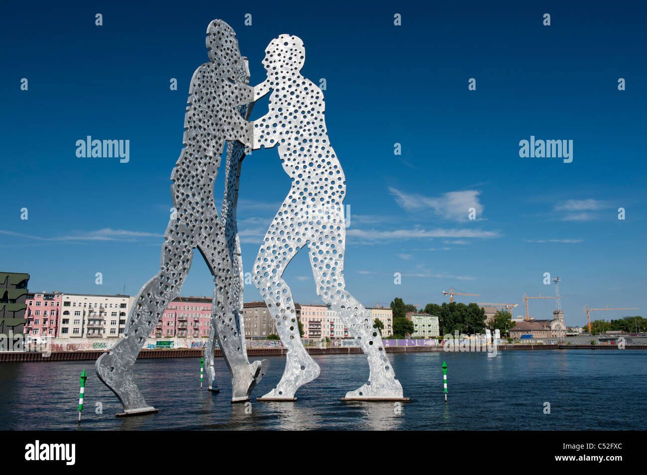 Huge Metallic sculpture called Molecule Man by Jonathan Borofsky in Spree River Berlin - Stock Image