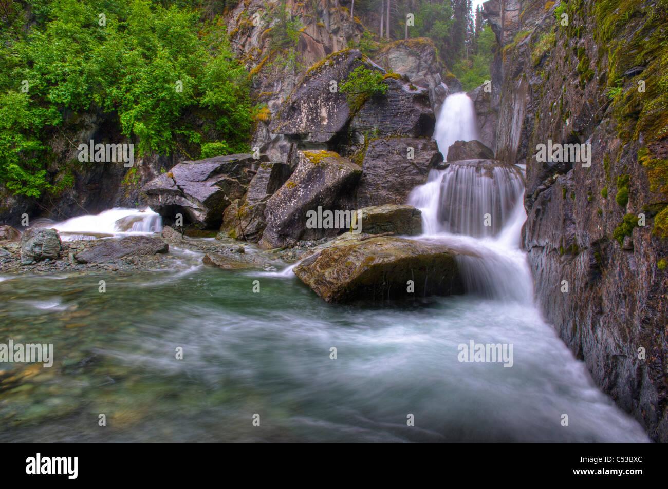 View of Liberty Falls at Liberty Falls State Campground near Chitina, Southcentral Alaska, Summer, HDR image. - Stock Image