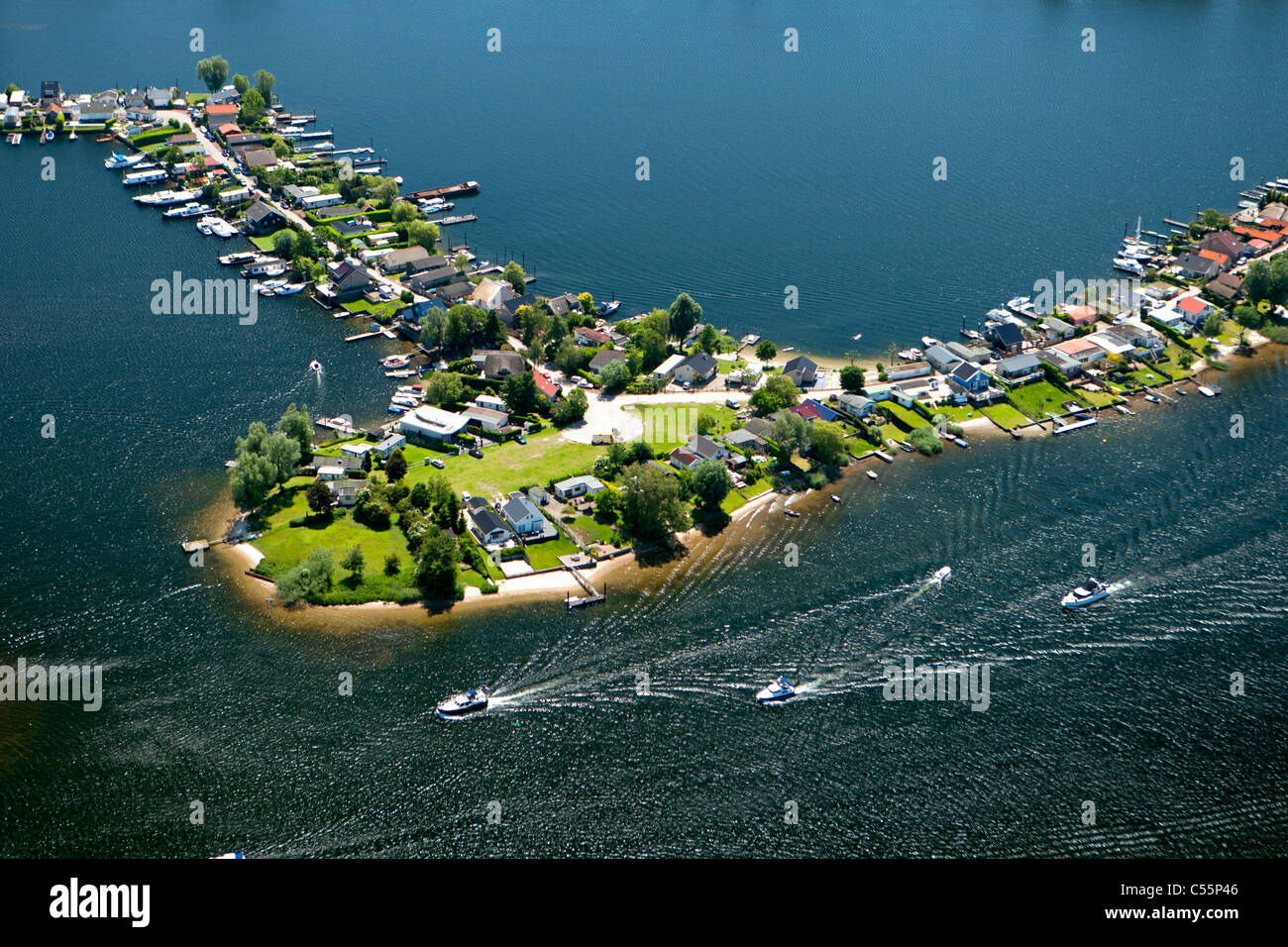 The Netherlands, Veen, Aerial, holiday houses on peninsula. - Stock Image