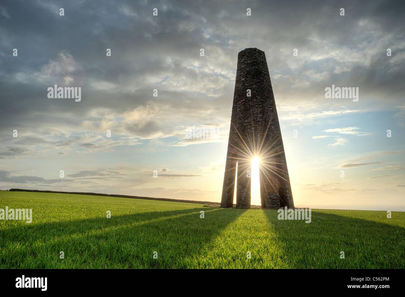 A summer sunrise through the Daymark navigation tower near Kingswear, South Devon. - Stock Image